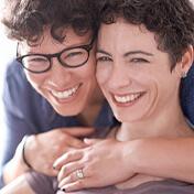 Two women smiling cheek-to-cheek
